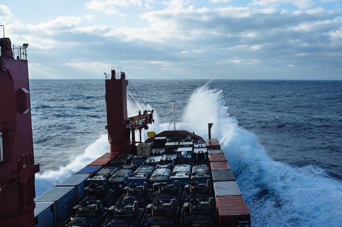 Filson Life - John Dunaway, Merchant Marine barge with military vehicles casting sea-spray high off the bow