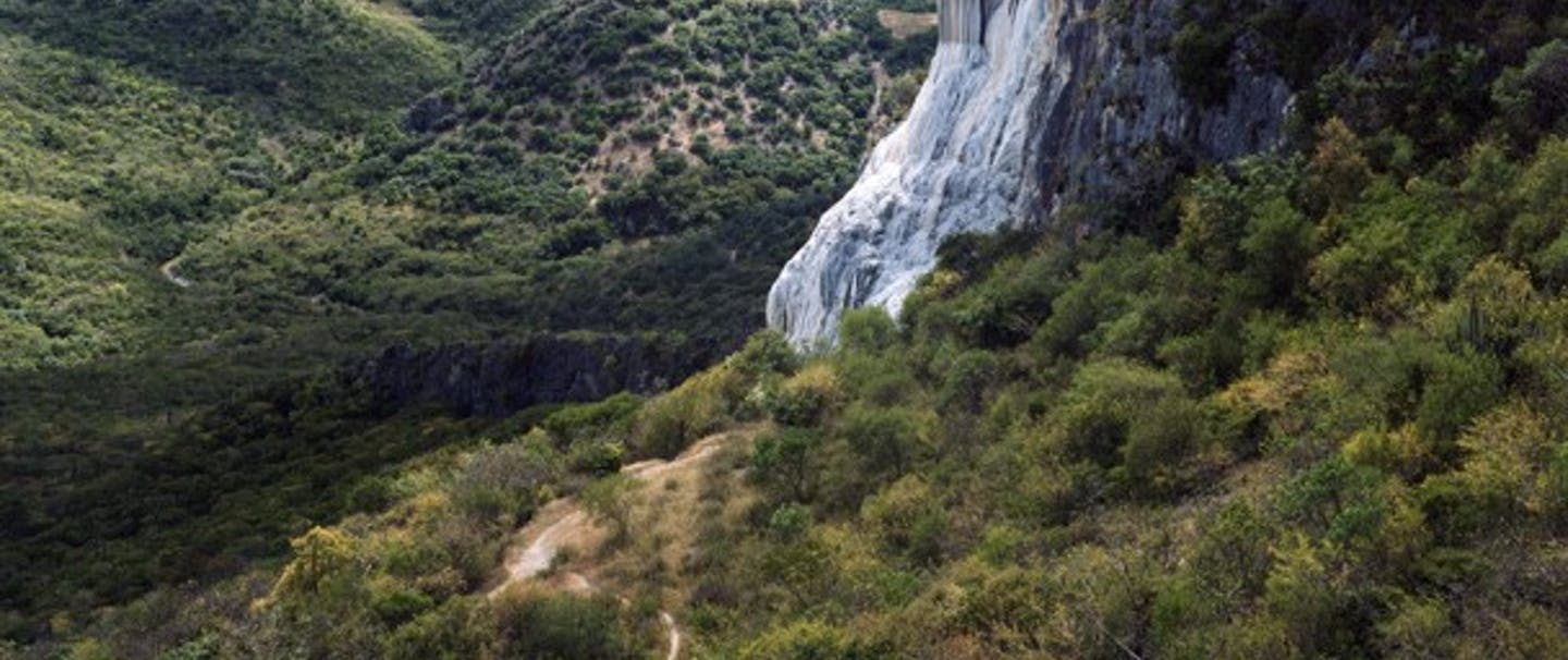 petrified waterfall hierva agua amongst rolling green hills