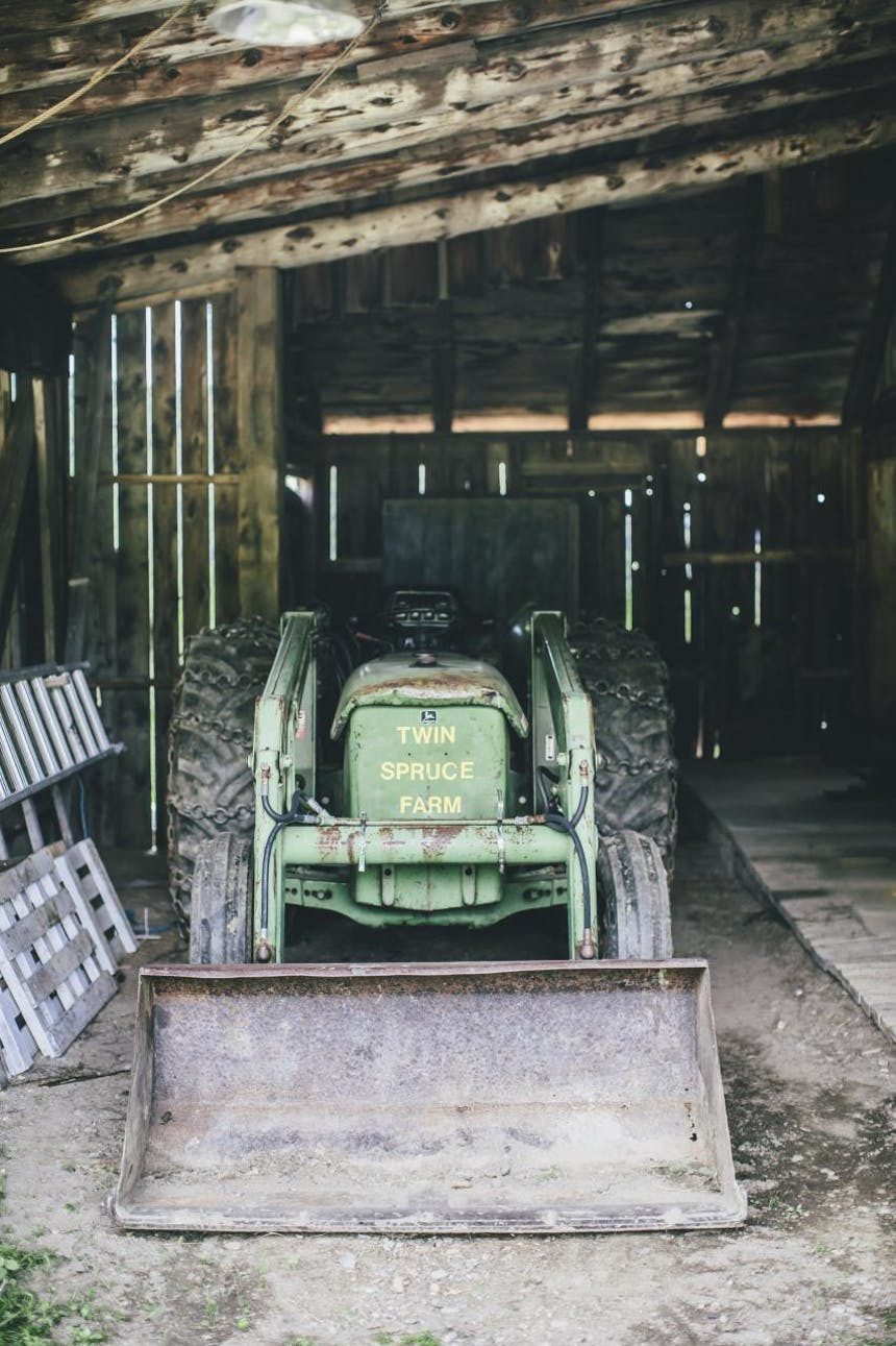 bulldozer parked in wooden barn