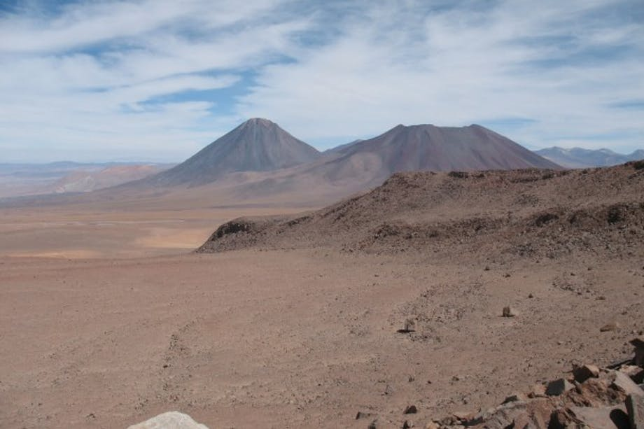 stark high Andean desert with severe brown mountain peaks
