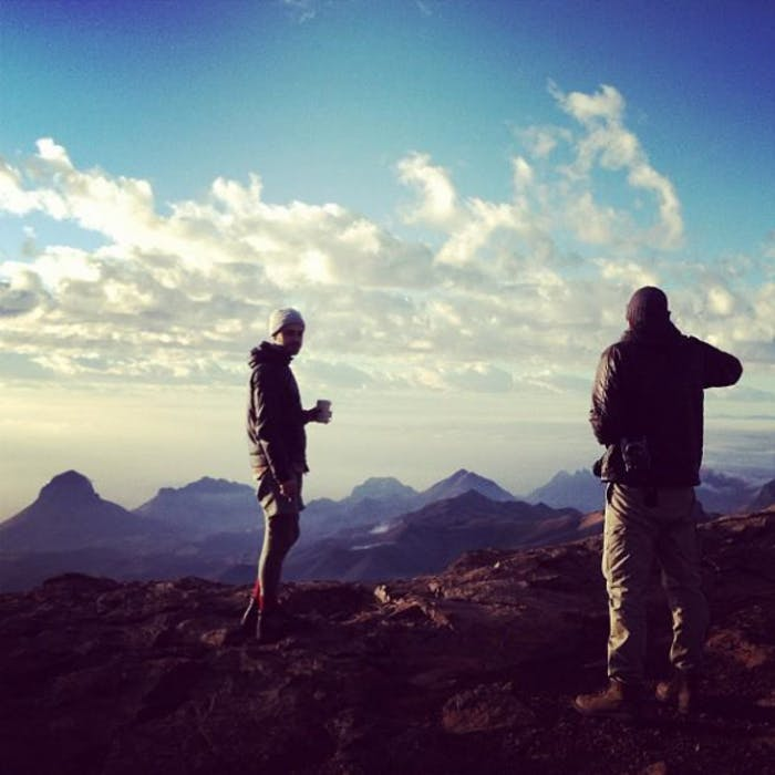two people look from a hilltop over big-bend