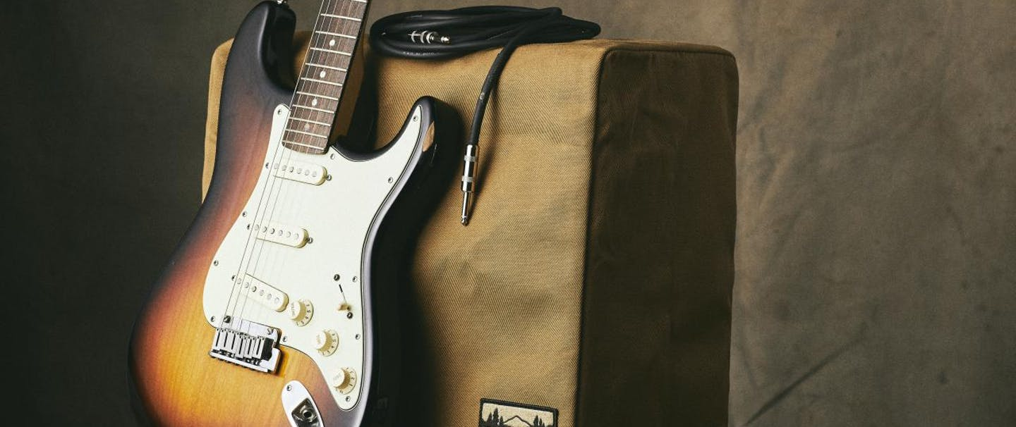 Fender guitar and amplifier with filson cover on amplifier