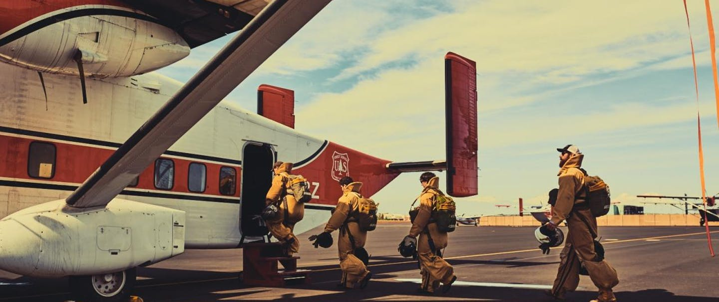 Smokejumpers boarding plane