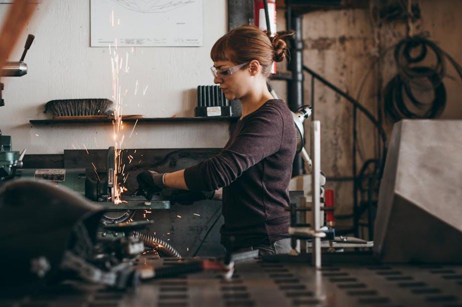chelsea grinding metal at workshop grinding station