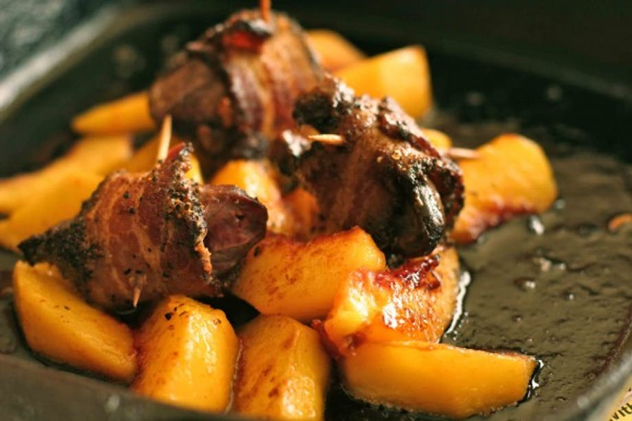duck breast wrapped in bacon with grilled peaches