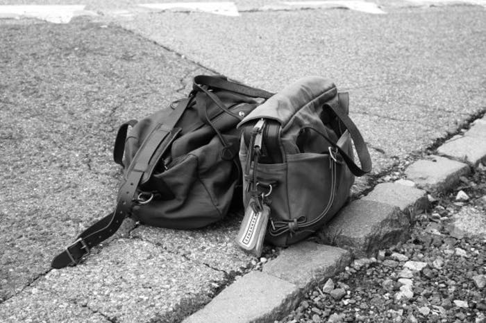 Filson Luggage on asphalt street in Black and White