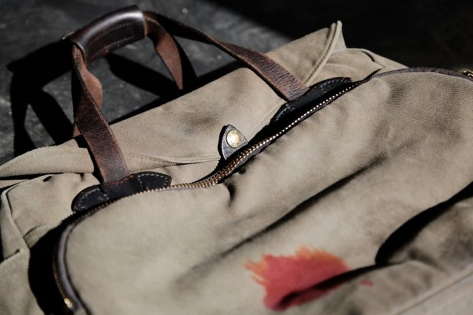 Beige Filson Padded Computer Bag with brown leather straps