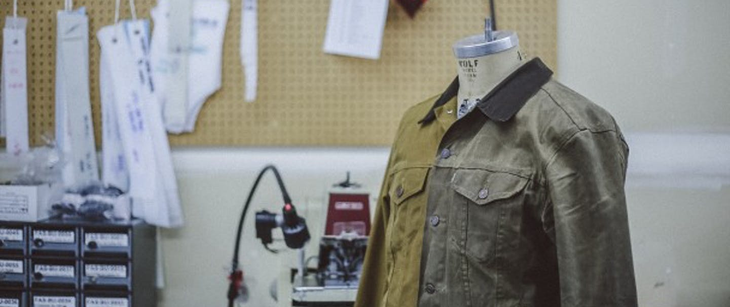 Filson two toned green Trucker Jacket on mannequin