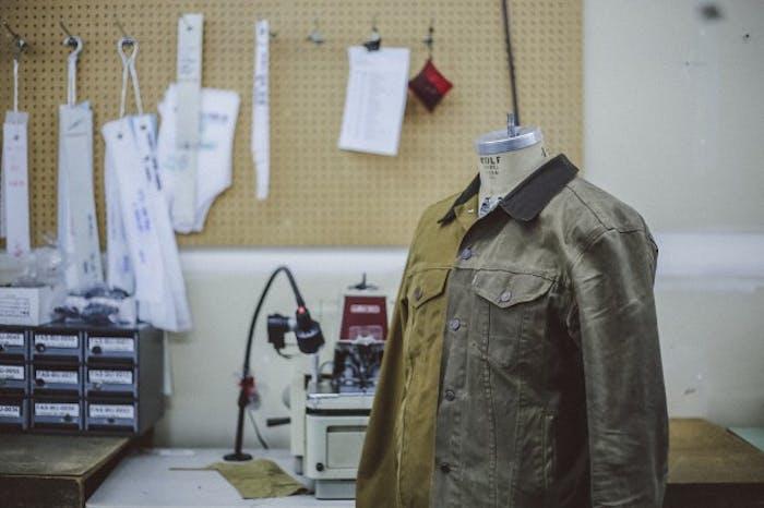Filson two toned green Trucker Jacket on mannequin