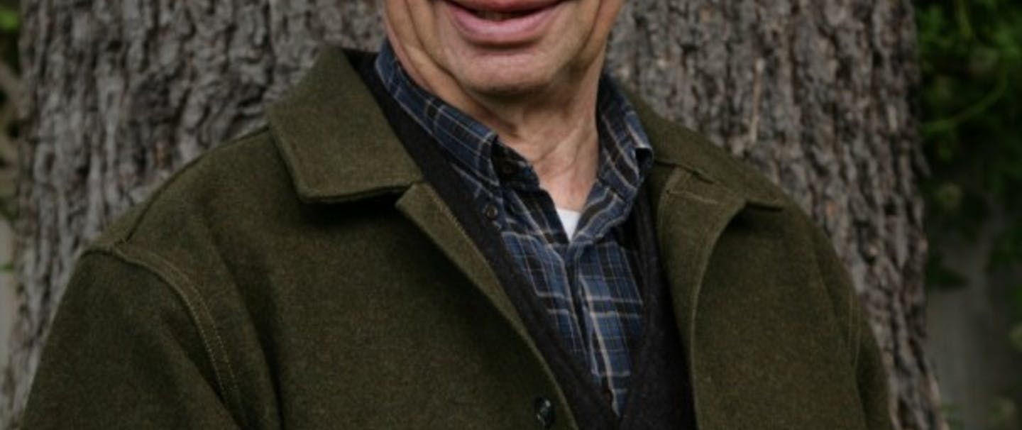 Paul Hanson in green wool jacket, black stetson hat and blue plaid shirt