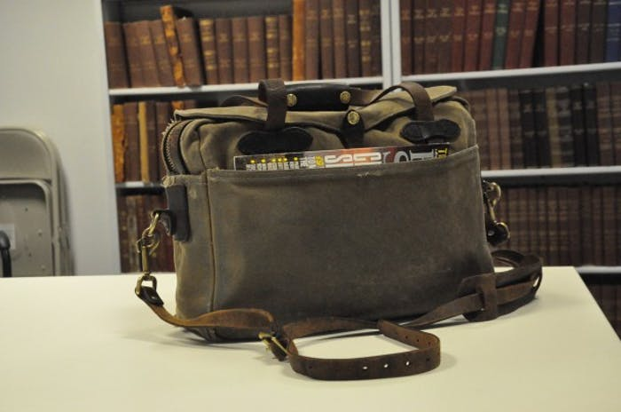 Filson Briefcase on table in library