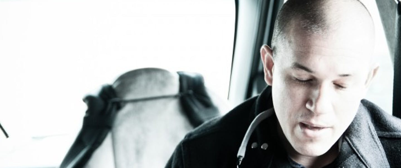 Jason Ramos in black coat in vehicle