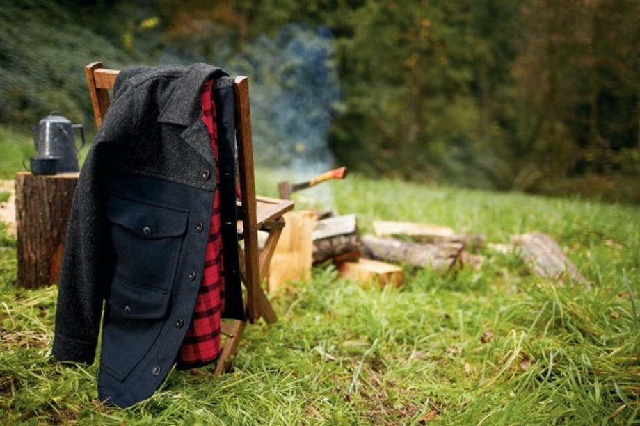 Black Lined Seattle Cruiser hung over chair at campsite