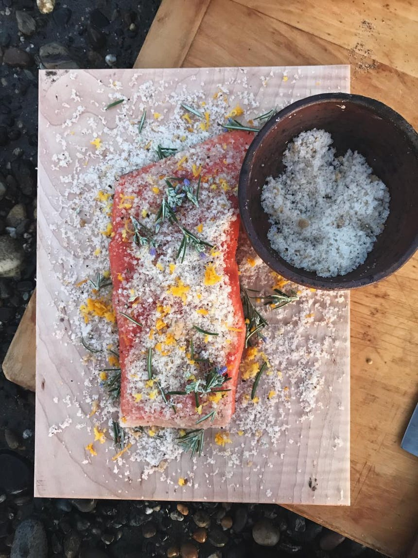 salting the fish with herbs and citrus zest