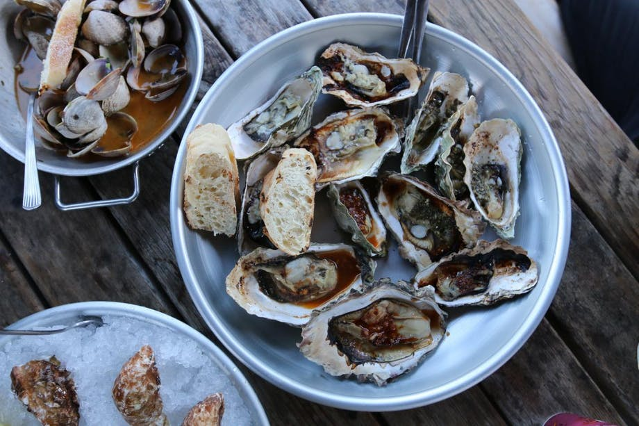 oysters and bread in bowls