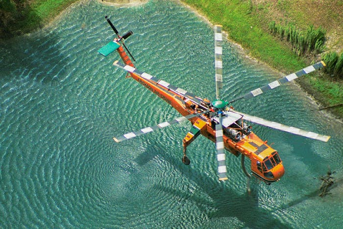 Helicopter flying over pond