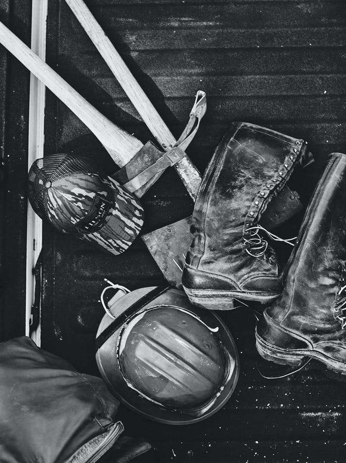 black and white firefighter gear on wood floor
