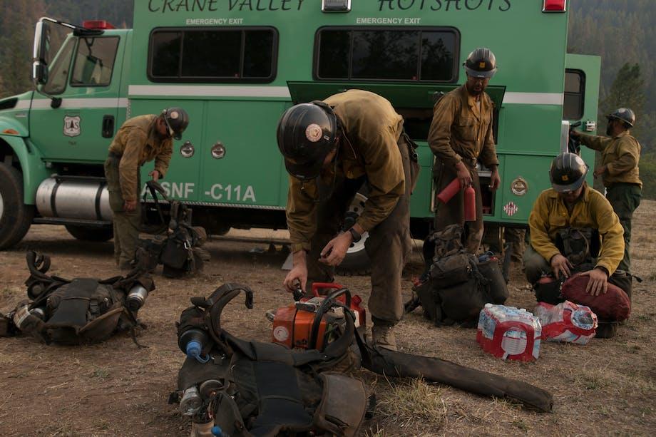 Hotshots getting their gear ready from truck