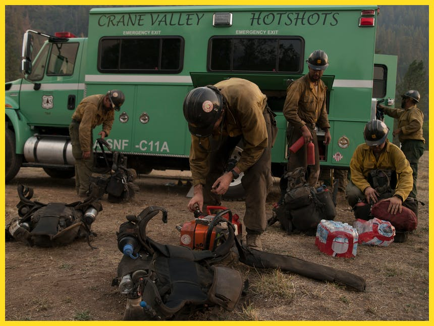 Hotshots packing gear from truck