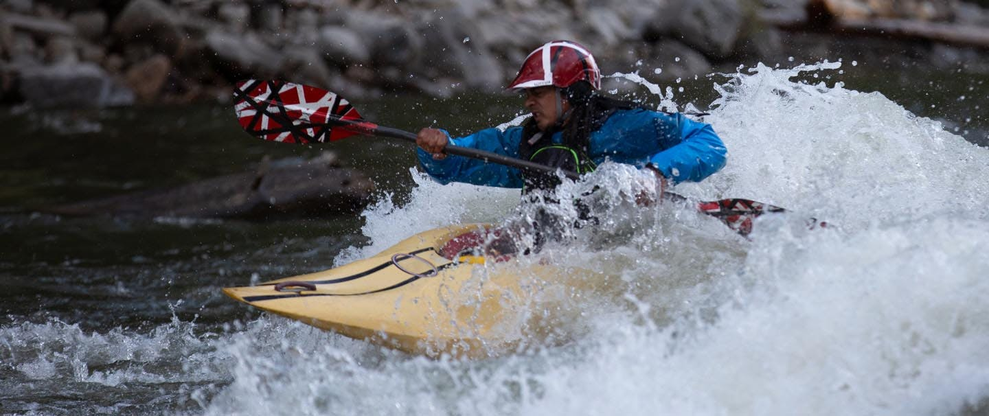 Ryan Bailey Kayaking over whitewater
