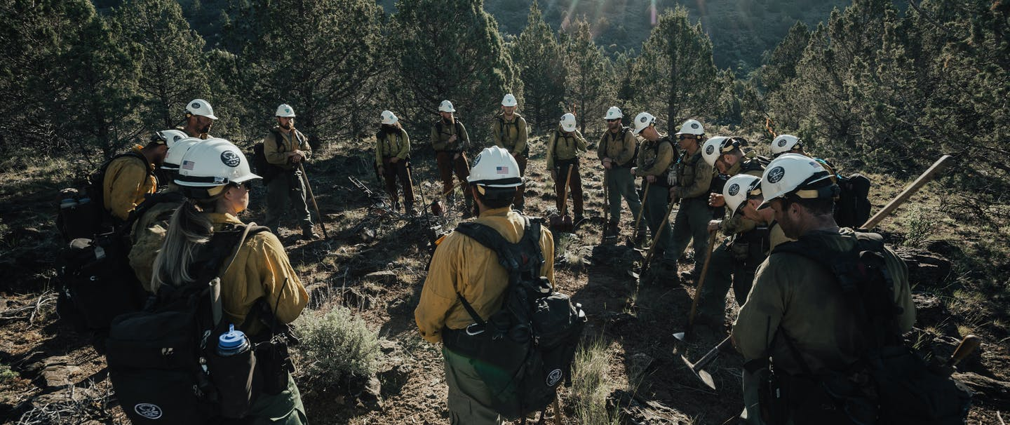 veterans hot shot crew in circle in forest