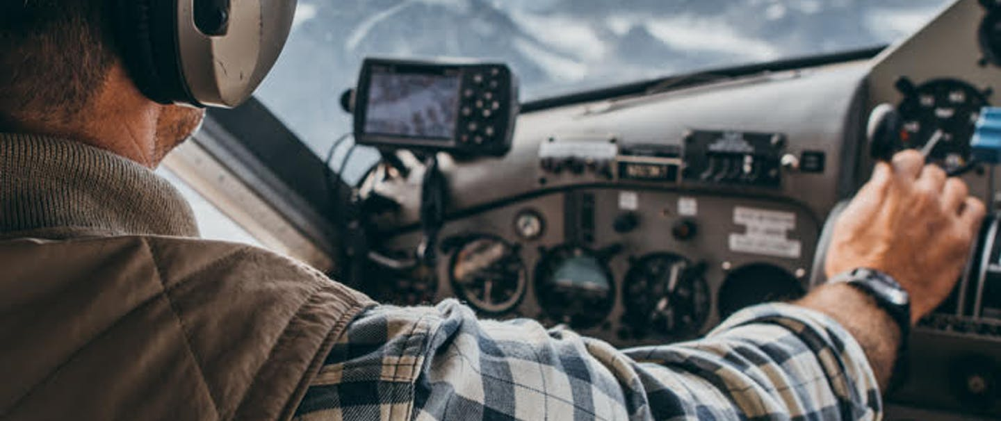 Pilot flying over mountains