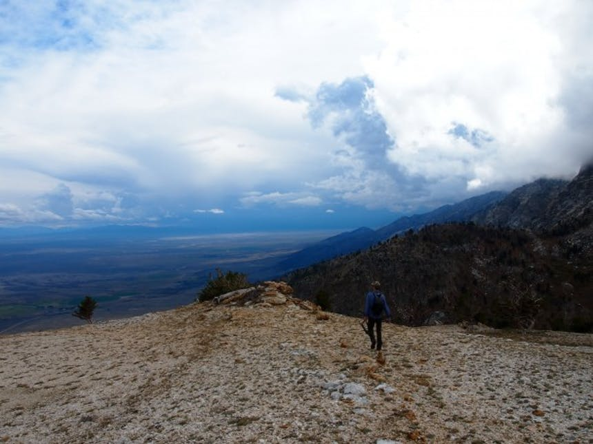 man walking towards ridge
