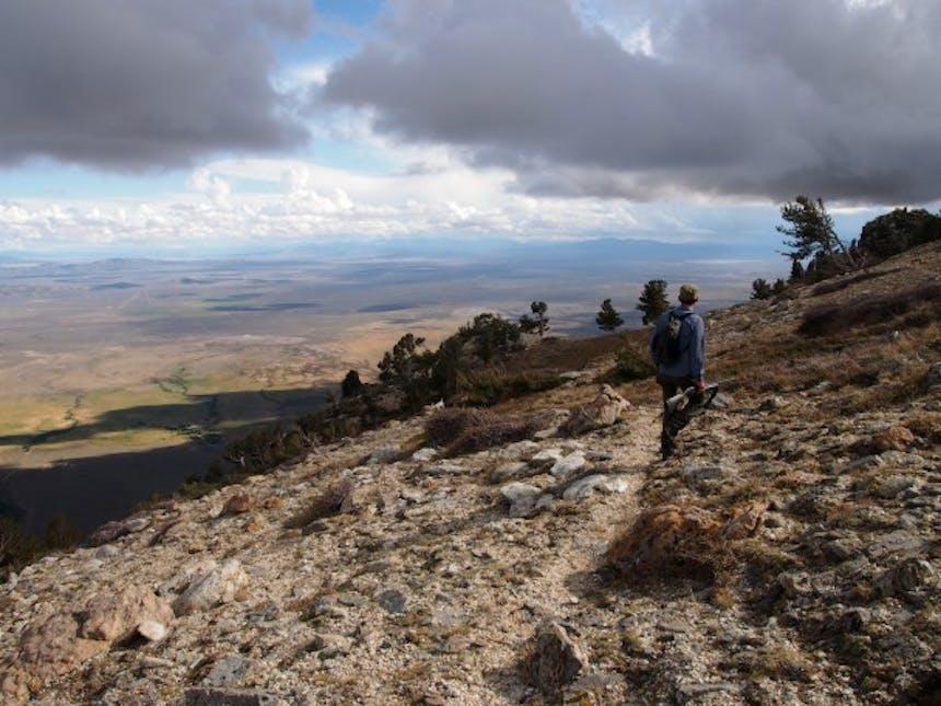 man walking down ridge