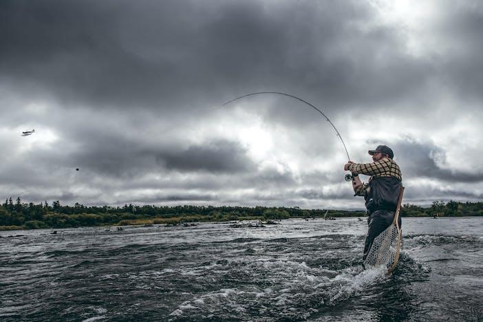 Alaska Fisherman reeling in fish