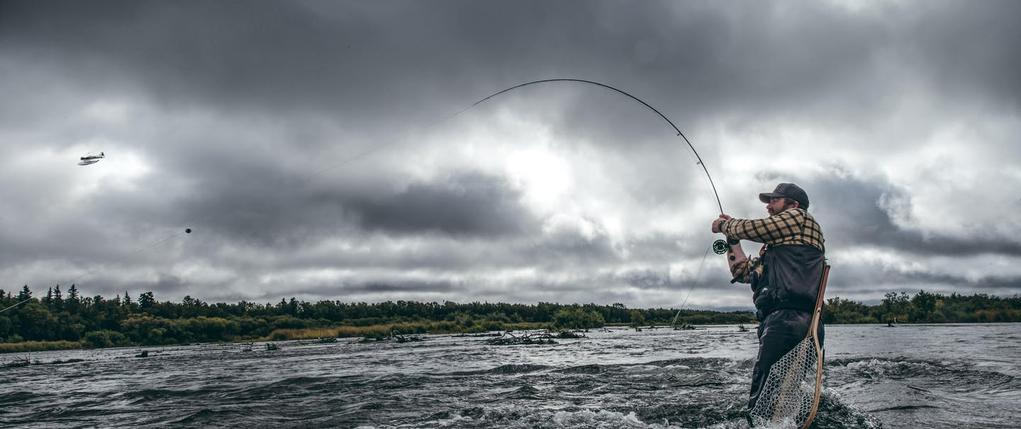 Alaska Fisherman reeling in fish