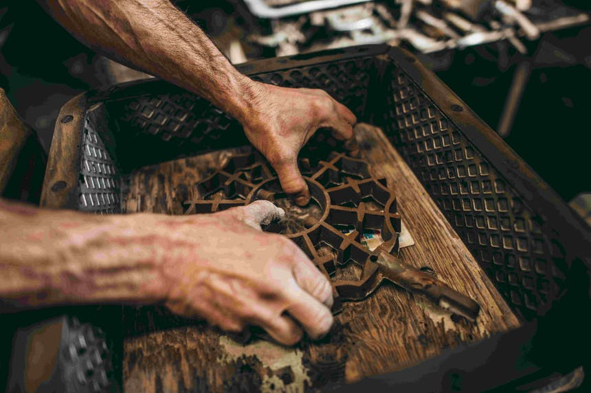 man working with metal mold