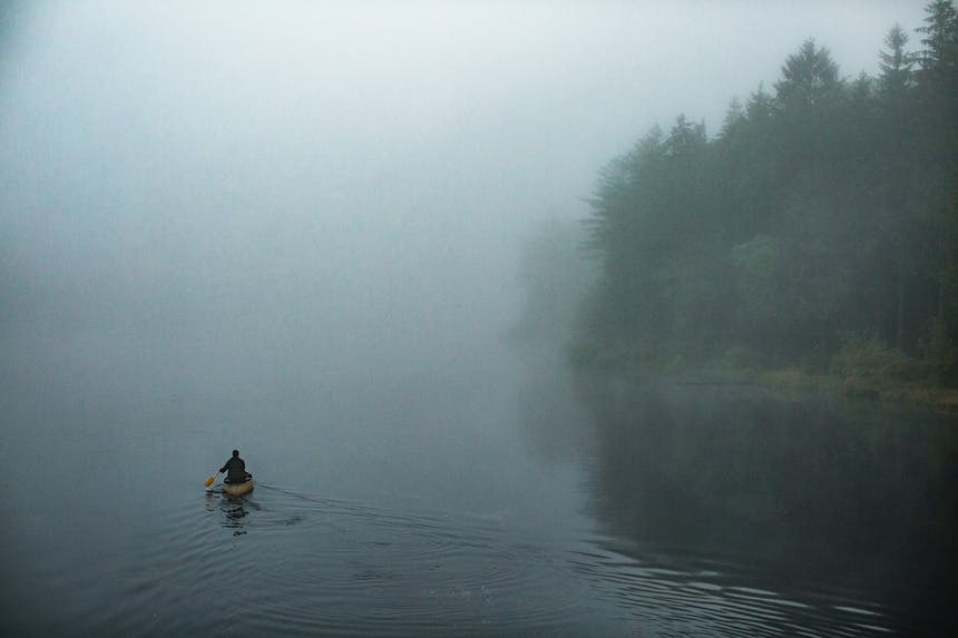woman canoeing on foggy day