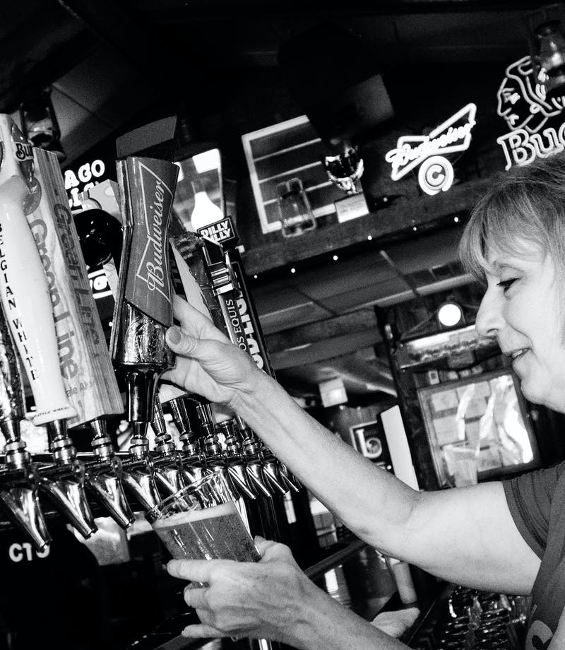 bartender pouring beer from tap