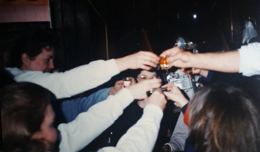 group of friends cheering drinks together