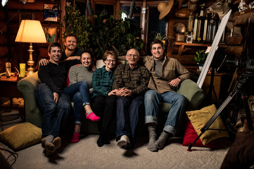 film crew and interviewees, Gary and his family huddled together on their cabins couch after shooting concluded