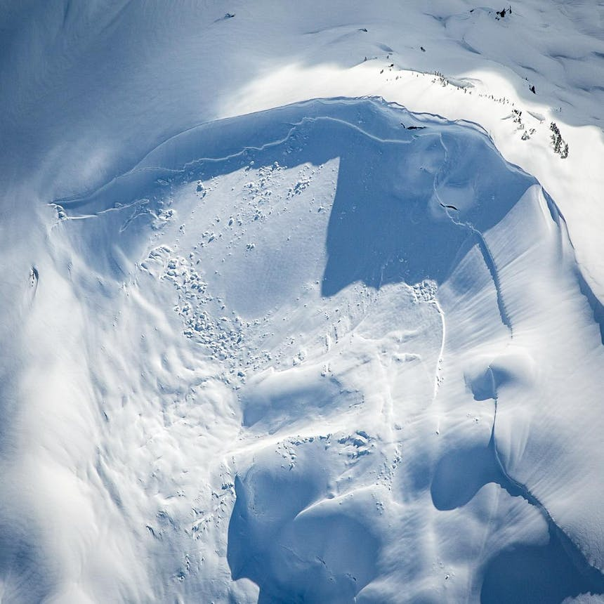an areal view looking down of a swirl of snowpack