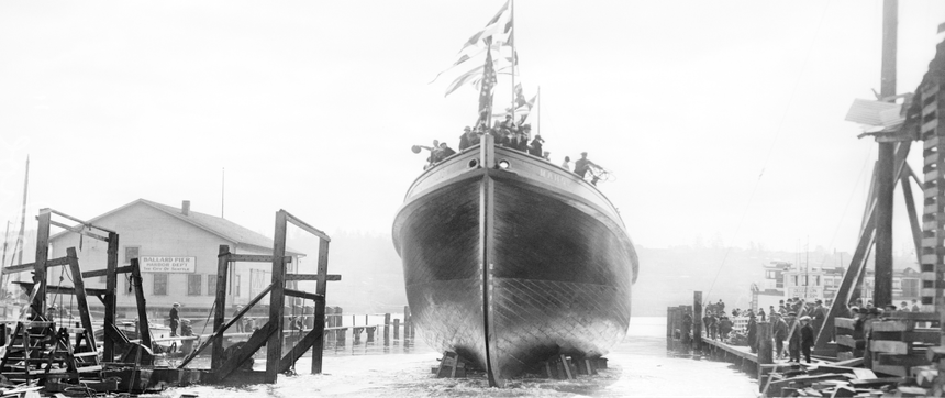a black and white image of a boat in a boat yard being sent off into the water