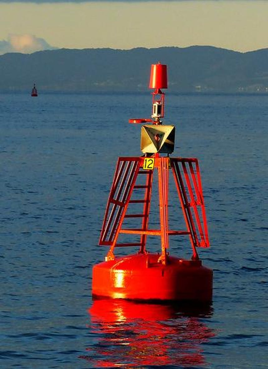 an image from a boat of a red buoy