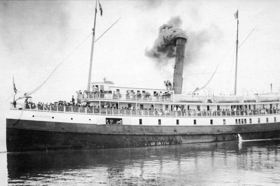 a black and white image of the bow of the SS Clallam with passengers prior to its sinking