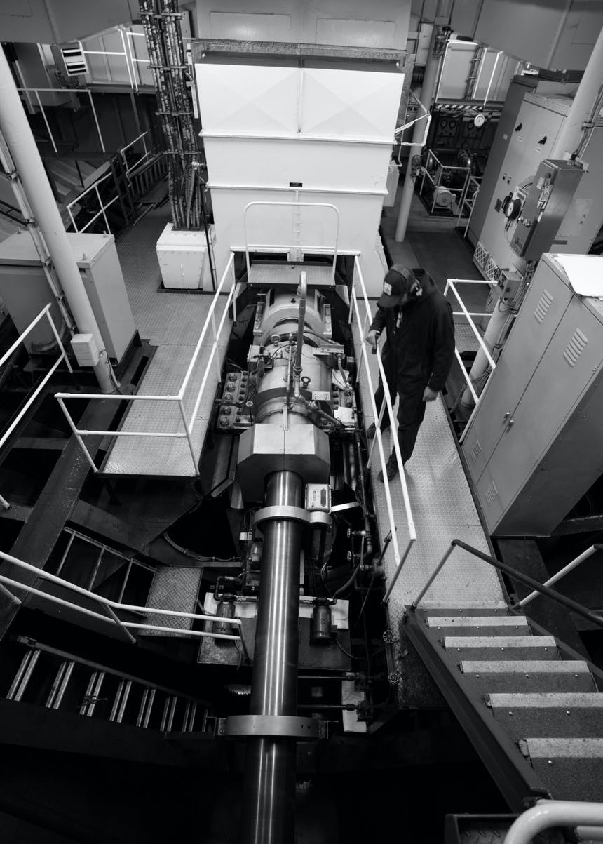 a black and white image of a top down view of the interior of a ferry mechanics room