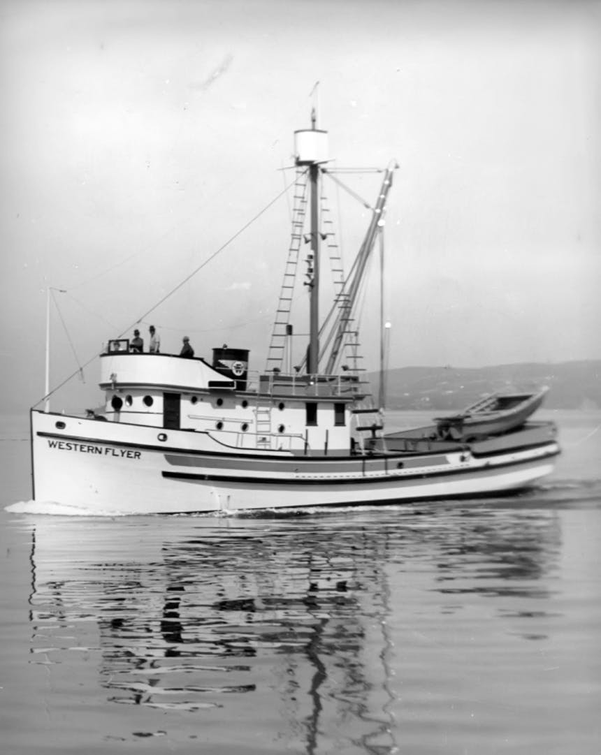 black and white image of white fishing vessel named