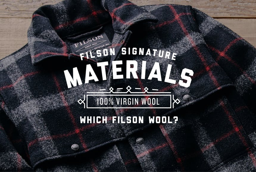 a lay down of a black, white and red flannel pattern Filson Mackinaw Wool Cape Coat with text overlay reading, Filson Signature Materials, 100% Virgin Wool, Which Filson Wool?