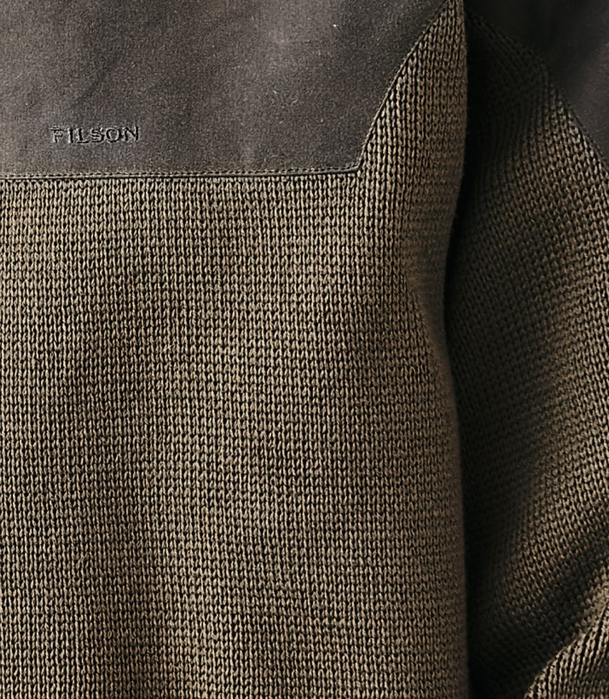 a close up of a merino wool pullover material, clearly showing the weave