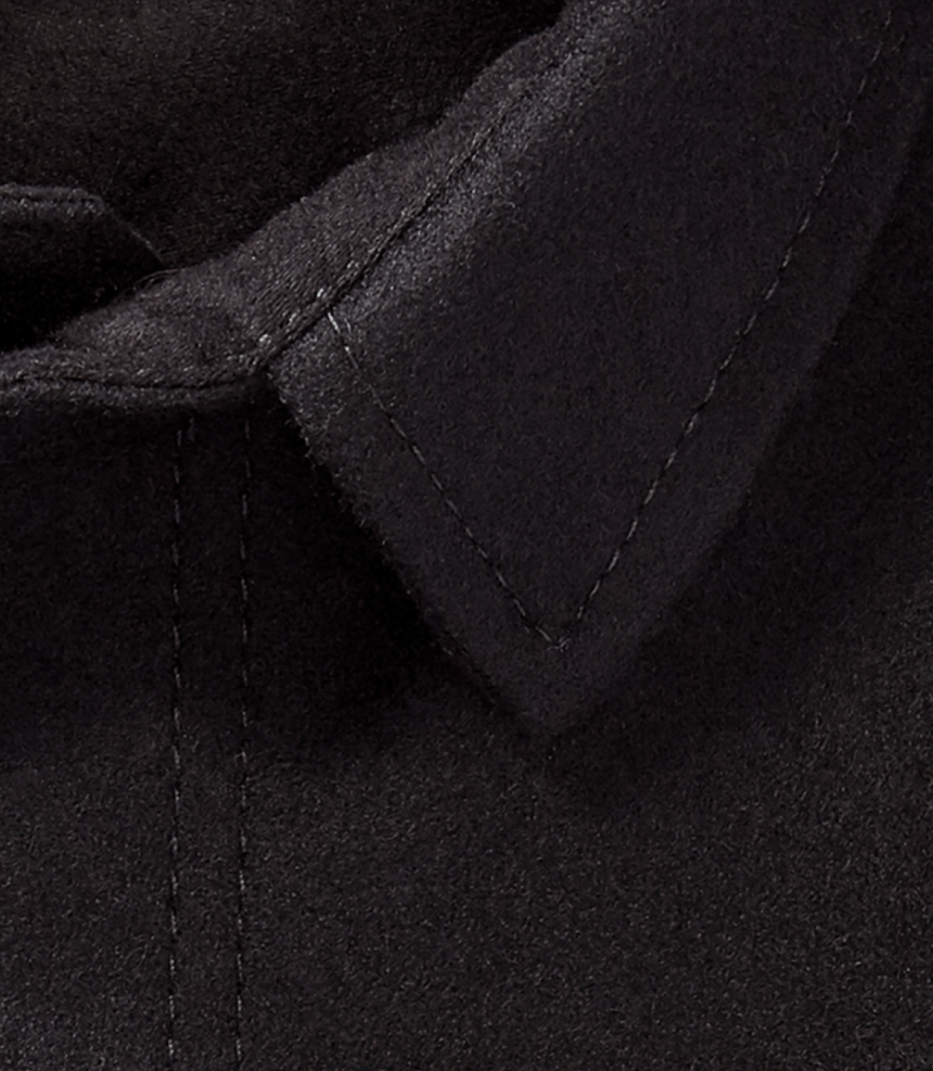 a close up view of a black wool jacket along the collar