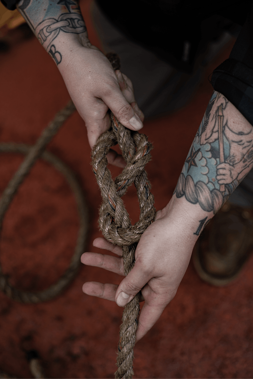 hands tying figure eight knot
