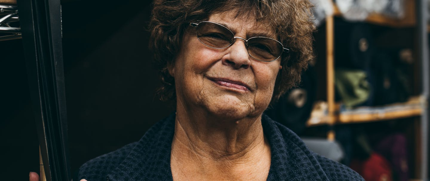portrait of middle aged woman with tinted glasses in a fleece vest