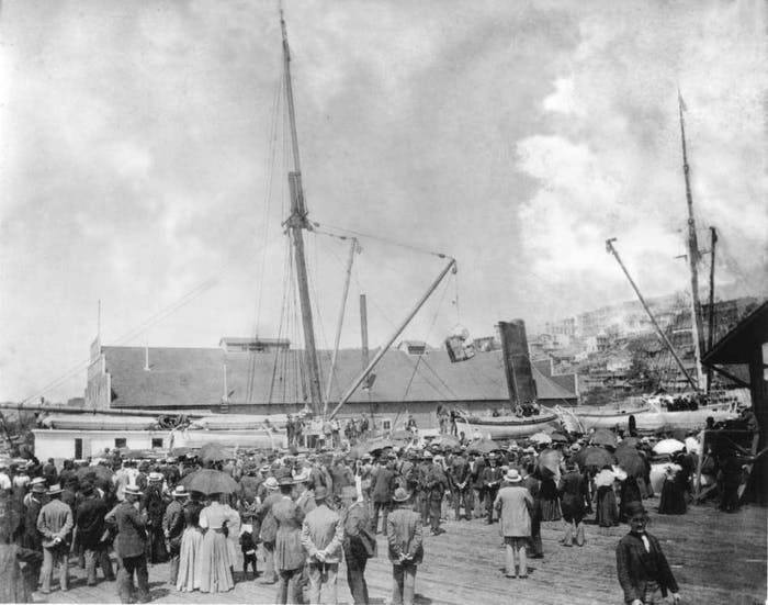 Black and white image of a crowd looking at the SS Portland at Schwabachers Wharf