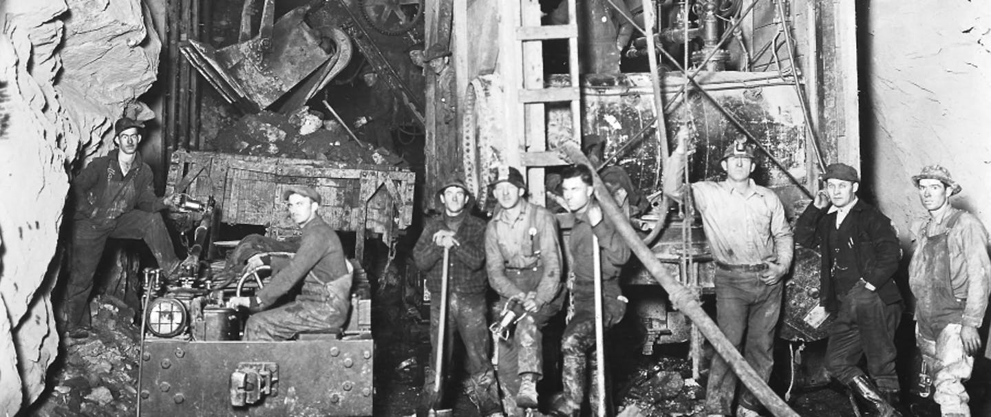 black and white archival image of crew of men working on the great cascade tunnel
