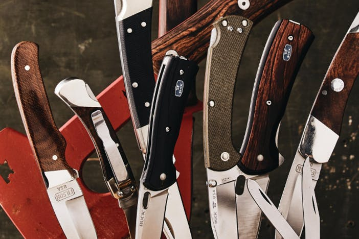 top down view of a collection of filson folding knives