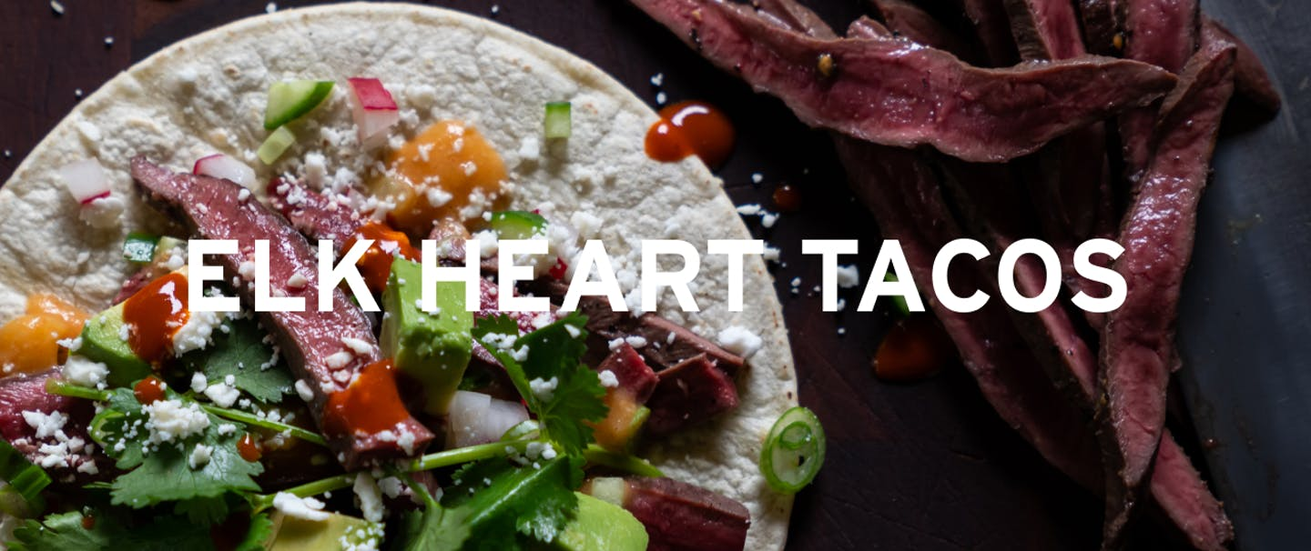 Elk heart meat taco with cilantro and avocado and cotija cheese
